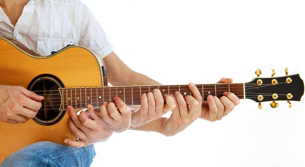 Guitar master instructor play his acoustic guitar with magical multiple hands